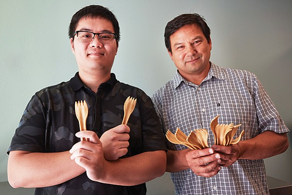 "Zack Kong, CEO and founder of TwentyFifty Fork, at left, and his mentor Albert Liu. The company produces compostable utensils. ""The plan is to produce 180,000 a day to start, and then, by the end of next year, 300,000 units per day, for a total of close to 10 million a month,"" said Liu."