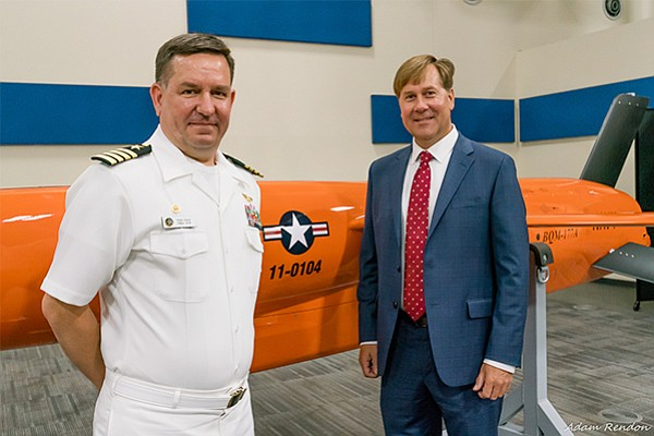 U.S. Navy Capt. Tom Cecil, left, takes delivery of the first production BQM-177A target drone from Kratos Defense executive Steve Fendley July 11 near Kratos' Sacramento factory. Photo by Adam Rendon/courtesy of Kratos Defense & Security Solutions Inc.