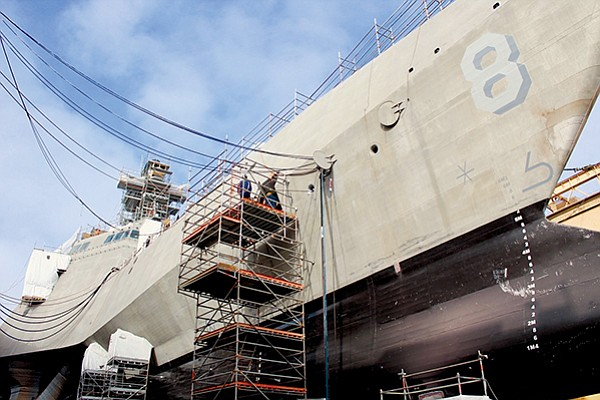 Shipyard workers upgrade the forward mooring station of the littoral combat ship USS Montgomery while in dry dock in 2017. The ship's original builder, Austal USA, recently moved its San Diego support office to a larger space to accommodate the growing fleet of Austal ships in San Diego. Photo courtesy of U.S. Navy