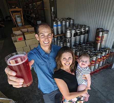 Jared and Deanne Gustafson, shown with their daughter Jade, launched Kombucha On Tap in 2014.