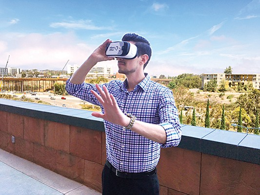 Gil Munguia of JLL uses Oculus virtual reality glasses to take a tour of the planned Millenia Office project in Chula Vista. Photo courtesy of JLL