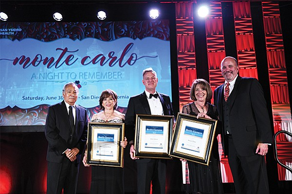 Macario Gutierrez, left, Chula Vista Mayor Mary Casillas Salas, Congressman Scott Peters, Congresswoman Susan Davis and Kevin tMattson, president of San Ysidro Health at the nonprofit's annual gala. Photo credit J. Dixx Photography