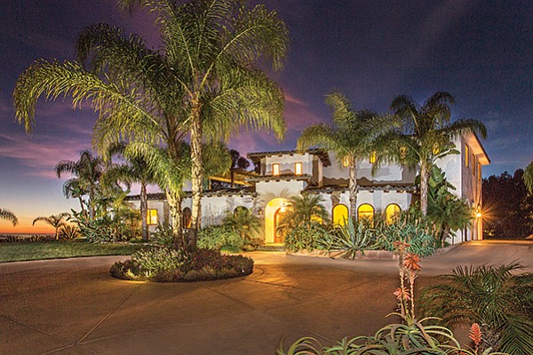 A home at 3544 Lone Hill Lane at twilight in the Olivenhain community of Encinitas. Photo courtesy of Distinctive Homes California
