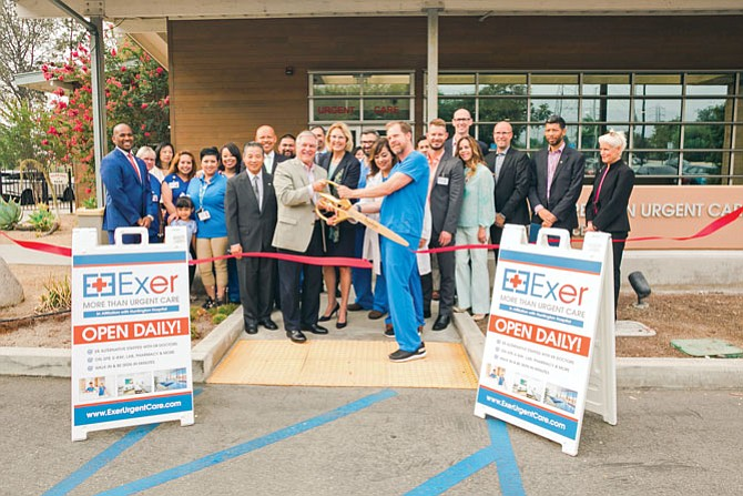 Exer executives with others at ribbon cutting for Pasadena Clinic.