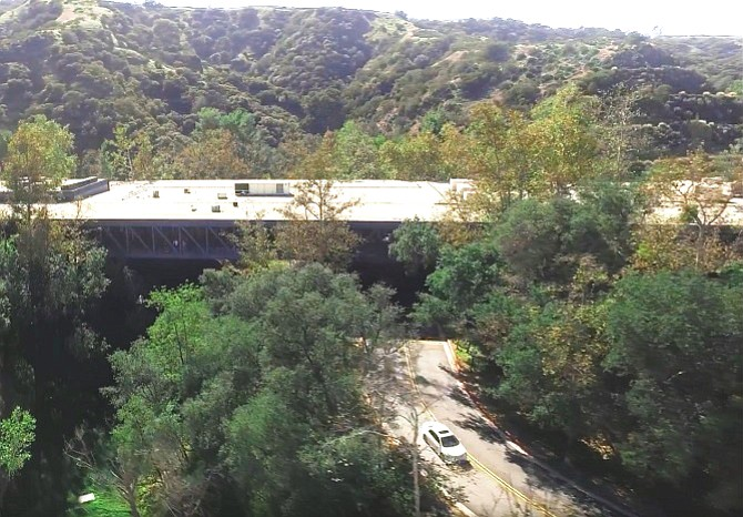 The steel and glass bridge spans an arroyo on the Art Center's hillside campus north of the city center.