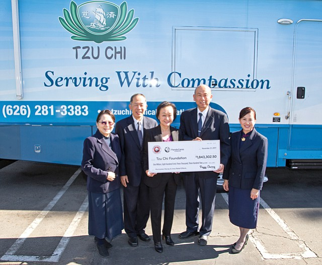 Storm Aid: Panda Restaurant Co-CEO Peggy Cherng with Tzu Chi Foundation.