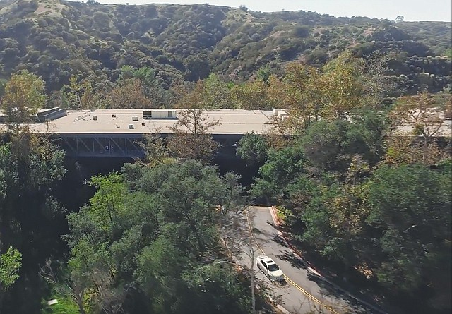 Arroyo Renovation: Steel-and-glass bridge due for makeover.