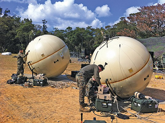 U.S. Marines tend to a pair of satellite dishes made by GATR Technologies, a Cubic Corp. subsidiary. The U.S. Army has just ordered more than $500 million in GATR dishes as well as spares and training. Photo courtesy of Cubic Corp.