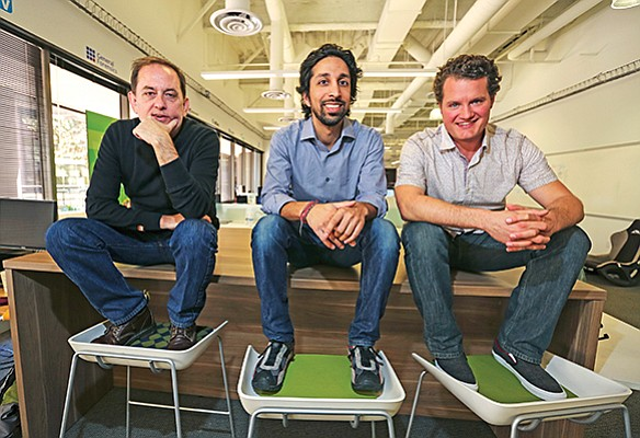 From left, Mark Pitman, Navtej Sadhal and Andy Taylor, of digital mortgage startup Approved, pose for a photo in 2017 in the EvoNexus incubator space in downtown San Diego, where the company worked for a time.