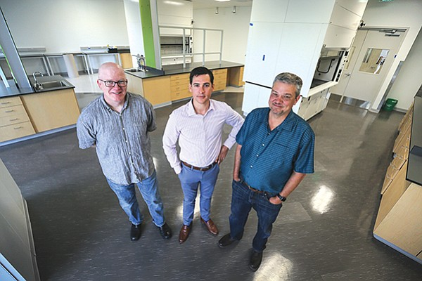 Crinetics Pharmaceuticals recently raised $102 million through an initial public offering. Standing right to left in Crinetics' lab space that's under construction: CEO Scott Struthers; chief financial officer Marc Wilson; and Steve Betz, a co-founder and vice president of biology.