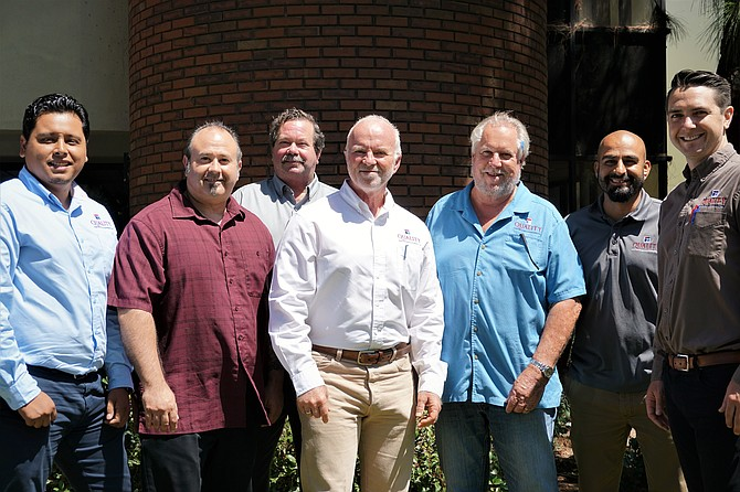 Edgar Avila, from left, David Friend, Rob Wicker, John Phipps, Joe Coughlin, Juan Prieto, Colin Cronin.
