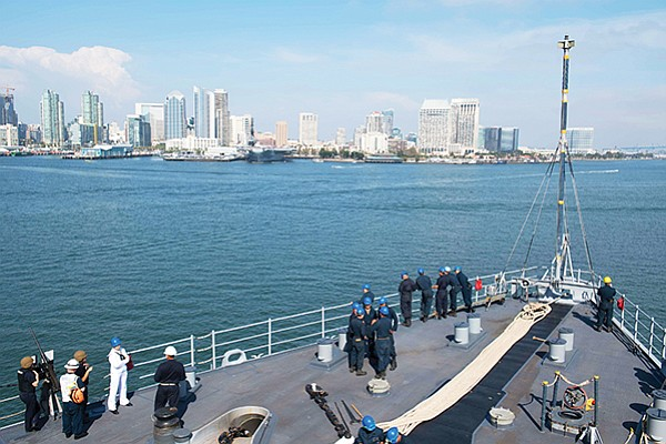 Sailors aboard the amphibious dock landing ship USS Harpers Ferry pass the San Diego waterfront July 26. The Defense Department spent an estimated $25.2 billion in San Diego in 2017, according to SDMAC's annual economic impact study. Photo courtesy of U.S. Navy