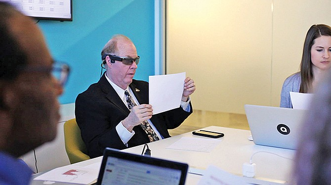 Aira's Michael Hingson demonstrates how the company's technology works in a workplace or campus setting. The Aira service connects blind and visually impaired people with sighted agents who provide users with visual interpretation. Photo courtesy of Aira