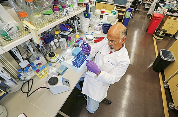 Research assistant Andres Berdeja at one of Ionis' labs in Carlsbad. Ionis pioneered antisense drugs that bind to RNA instead of proteins, which have been the focus of the pharmaceutical industry for more than 100 years. File photo by Jamie Scott Lytle