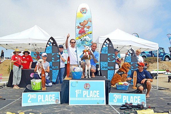 Best of Surf dogs 1st place winner, Sugar, center, Gidget, left, in second place and Turbo, right, in third place at the Helen Woodward Animal Center's 13th Annual Surf Dog Surf-A-Thon. Photo courtesy of Helen Woodward Animal Center