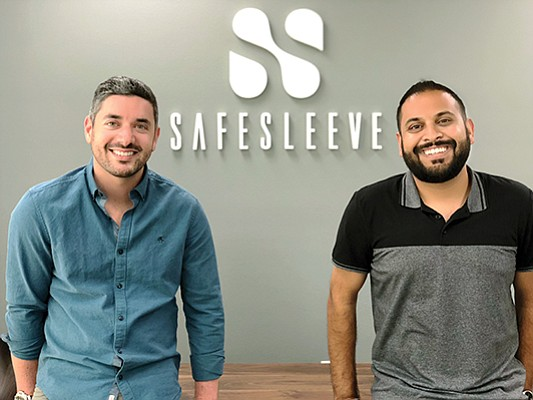 Cary Subel, left, and Alaey Kumar are co-founders of SafeSleeve, one of many companies selling products that block radio frequency energy from cellphones, tablets and laptop computers. Photo courtesy of SafeSleeve