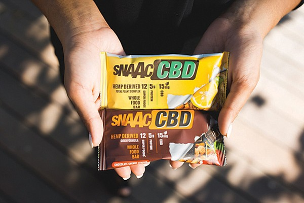 San Diego-based CV Sciences teamed up with Snaac Bar for the launch of its hemp-based CBD sports bar, Snaac CBD. Photo courtesy of CV Sciences and Snaak Bar