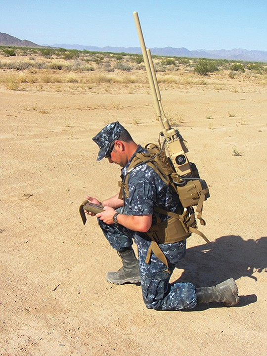 A sailor wears a JCREW signal jammer from Northrop Grumman Corp. in a 2014 photo. The system, built in San Diego, foils radio-controlled improvised explosive devices, or IEDs. JCREW stands for Joint Counter Radio-Controlled Improvised Explosive Device Electronic Warfare. Photo courtesy of U.S. Navy