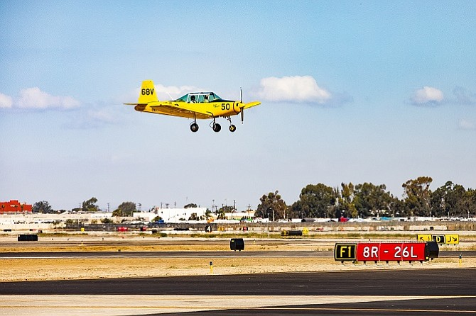 A ceremonial first flight in a Varga aircraft commemorated the opening of the 8R/26L reconstructed runway at Long Beach Airport.