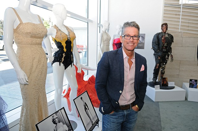 Glamour and Glitz: Reyes in front of Marilyn Monroe exhibit.