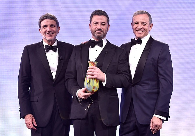CHLA's Chief Executive Paul Viviano, Jimmy Kimmel and Walt Disney Chief Executive Bob Iger at the Children's Hospital Los Angeles' From Paris With Love Gala. (photo by Getty Images)
