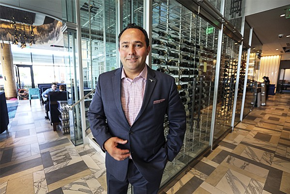 Del Frisco's Double Eagle Steakhouse's General Manager Michael Manoocheristands inside the 16,650 square foot, two-story restaurant at the waterfront InterContinental San Diego hotel in downtown.