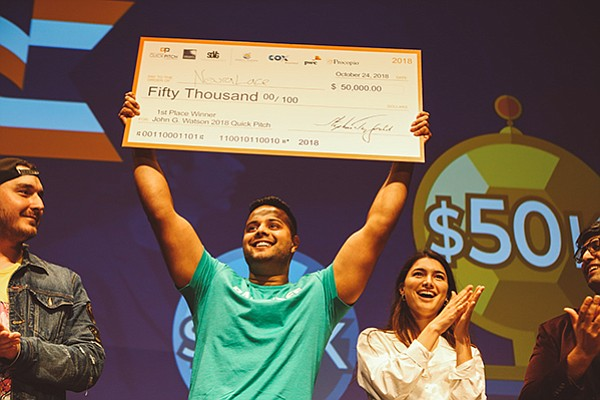 NeuraLace Medical, a startup that created a device to treat chronic pain, won the first place prize of $50,000 at the quick pitch competition. Founder and CEO Shiv Shukla (center) says he plans to use the funds for additional studies of the device. Photo courtesy of Carly Matsumoto