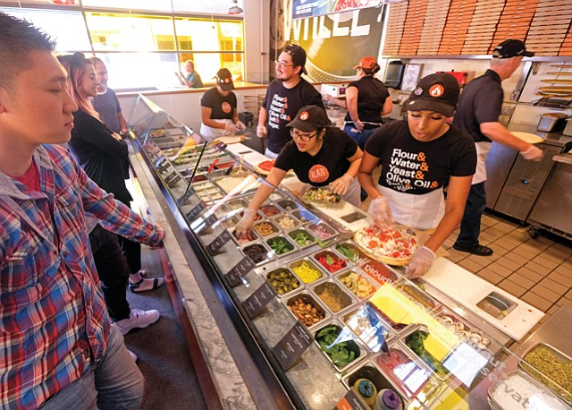 Pizza Party: Customers line up for Blaze's signature pies.