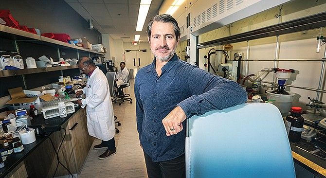Forge Therapeutics CEO Zak Zimmerman stands in the company's lab. Forge and other San Diego biotechs are taking on life-threatening infections called superbugs.