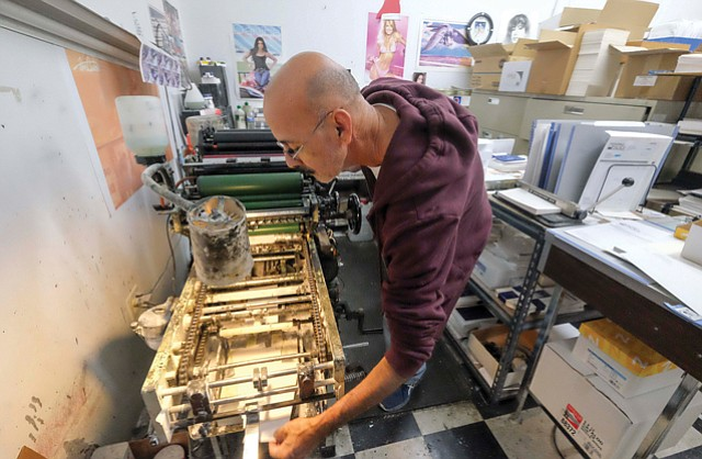 Helping Hand: An employee tends to a machine at MP Printing Palace Inc., whose owners used a $1.1 million SBA loan to help purchase the business.