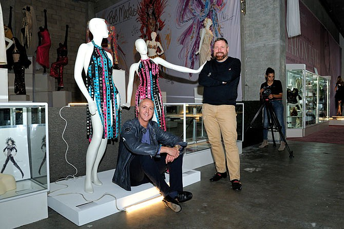 Darren Julien (right) and Martin Nolan of Julien's Auctions pose with celebrity gowns.