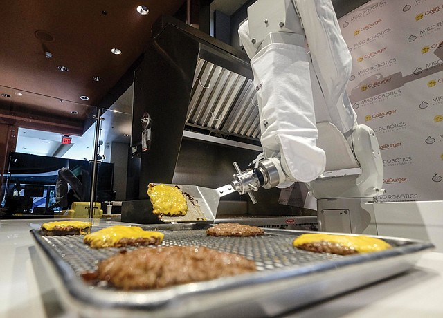 Flipping Script: Miso's robotic arm, dubbed Flippy, handles the grill at a CaliBurger restaurant.