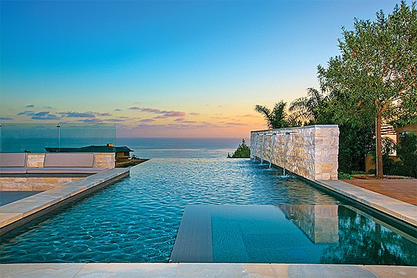 The view at sunset over the infinity edge pool at 715 Muirlands Vista Way in La Jolla. Photo courtesy of Berkshire Hathaway Home Services