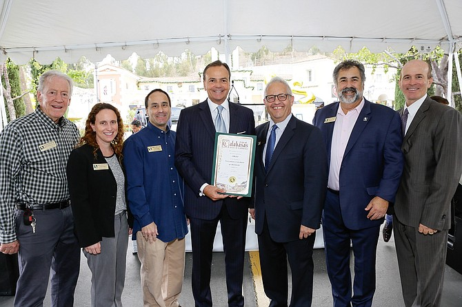 From left: First Calabasas mayor Dennis Washburn, City Council members Alicia Weintraub and James Bojazian, developer Rick Caruso with plaque, Mayor Fred Gaines, Mayor Pro Tem David Shapiro and City Manager Gary Lysik at the Commons at Calabasas 20th anniversary celebration.