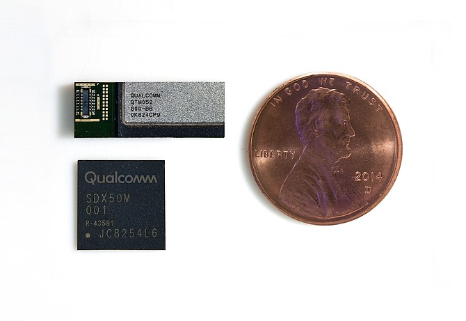 Qualcomm 5G electronics include the rectangular QTM052 antenna module and the square Snapdragon X50 5G modem. File photo courtesy of Qualcomm Inc.