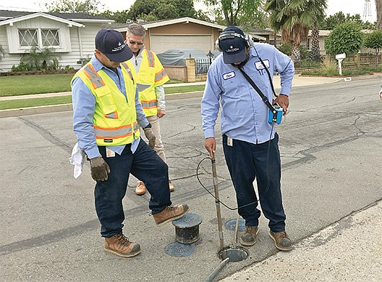 James Perry of Utilis, rear, joins a crew from California American Water to hunt down a leak in the water system of Duarte, a Los Angeles suburb. Utilis' satellite technology gives utilities the general location of water leaks. Photo courtesy of Utilis
