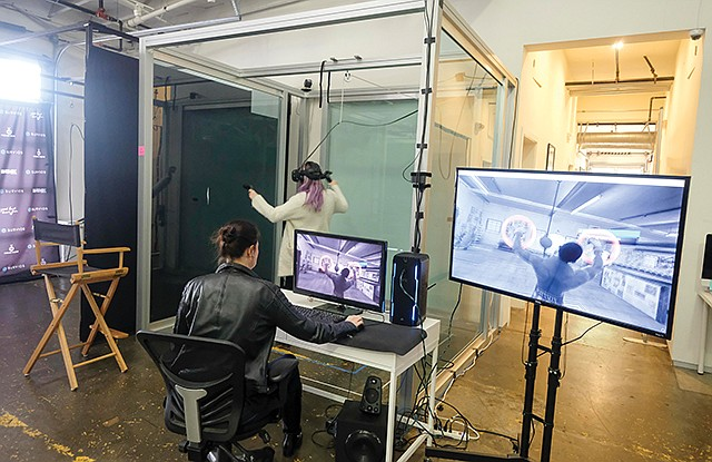 Play Time: Servios tests a VR game at its office.