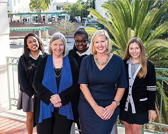Back Row: The Academy of Our Lady of Peace students Mariela Lopez-Oviedo, Kaseba Chibweth and Katie-Marie Zickert with Darlene Marcos Shiley, left, front row, and Lauren Lek, head of school, celebrate a $2 million donation from Shiley.  Photo courtesy of The Academy of Our Lady of Peace