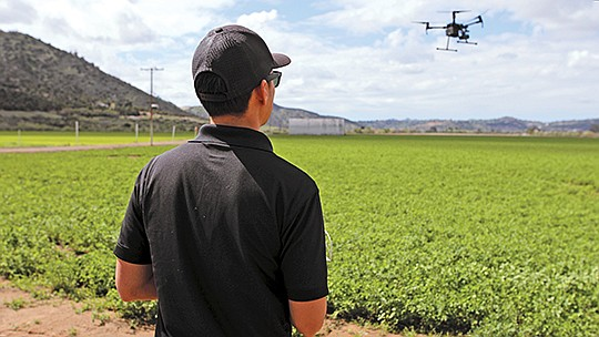 Above, SlantRange designs sensors and software that can be attached to drones to gather information about crops. Photo courtesy of SlantRange