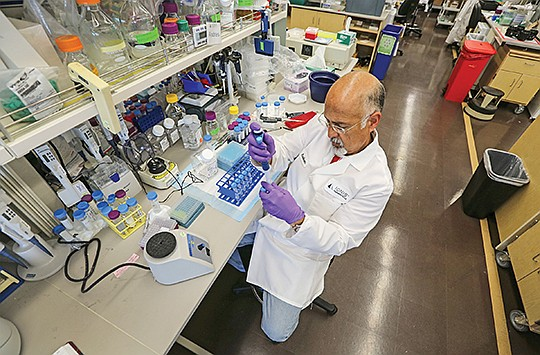Research assistant Andres Berdeja at one of Ionis' labs in Carlsbad. Ionis pioneered antisense drugs that bind to RNA instead of proteins, which have been the focus of the pharmaceutical industry for more than 100 years.