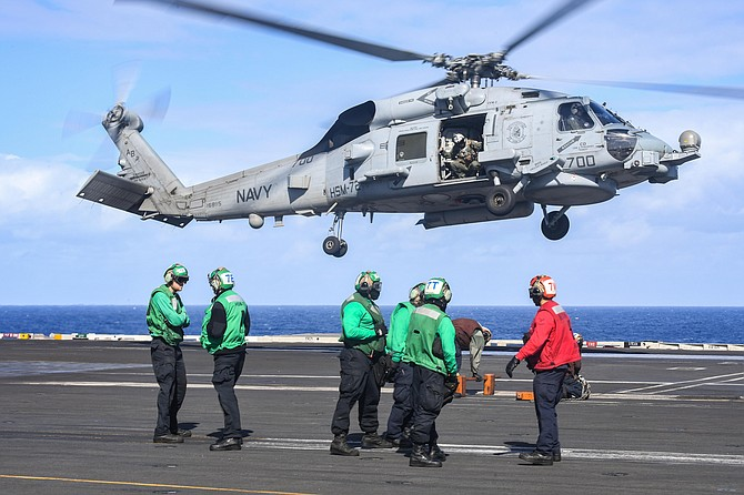 A Sea Hawk helicopter prepares to land on the deck of the aircraft carrier USS Harry S. Truman in the Atlantic Ocean in November. Photo by Mass Communication Specialist Seaman Joseph A.D. Phillips, courtesy of U.S. Navy.