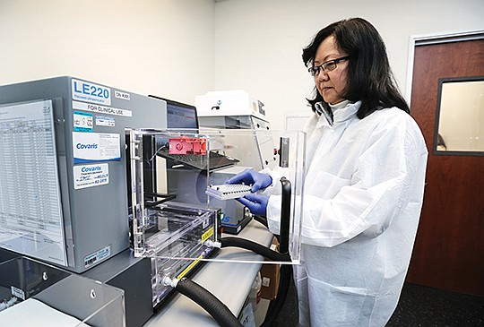 Jennie Le, a clinical laboratory scientist at Rady Children's Institute for Genomic Medicine works on fragment DNA.