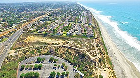 Aerial view shows the site of a 130-room luxury hotel by Fenway Capital Advisors and JMI Realty on a 4.3-acre coastal lot 
