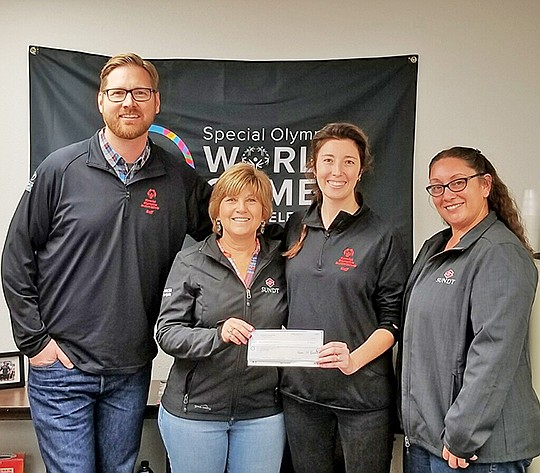 Brian Richter, left, regional director for Special Olympics, Vicki Trebian, Sundt Foundation board member, Amanda Baumann, development manager for Special Olympics and Maria Cruz, Sundt employee-owner, at a check presentation event. Photo Courtesy of Sundt Cos. Inc.