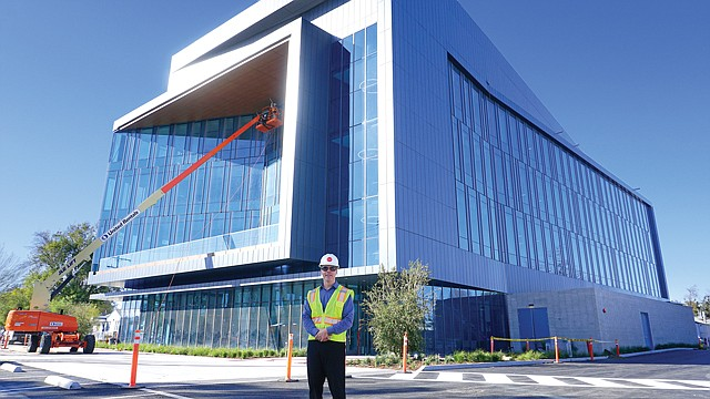 Building Bio: LA BioMed's Hoffman in front of new Torrance facility.