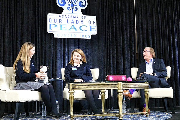 Student moderators Katie-Marie Zickert and Maggie  Brady interview Sony Chief Operating Officer Mike Fasulo for Our Lady of Peace's annual Architects of Change speaking event on Jan. 30. Photo courtesy of Our Lady of Peace