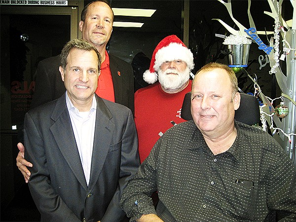Steve Becvar, ALS; left, Paul Negulescu, Vertex; Keith Miller (wearing Santa hat), ALS; Peter Grootenhuis, Vertex celebrate a $125,000 donation. Photo courtesy of the ALS Association Greater San Diego