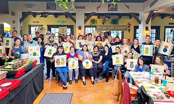 Kids celebrate a Promises2Kids mentor appreciation event at Rockin' Baja Lobster in Mira Mesa. Photo courtesy of Promises2Kids