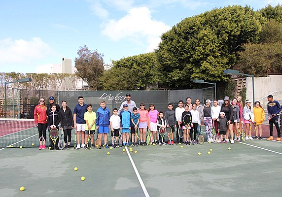 Love 15 Tennis hosted a fundraising 'tennis fest and clinic' to benefit a local student's goal of raising funds to build a home for families in Mexico for the local nonprofit Build A Miracle. Photo courtesy of Love 15 Tennis