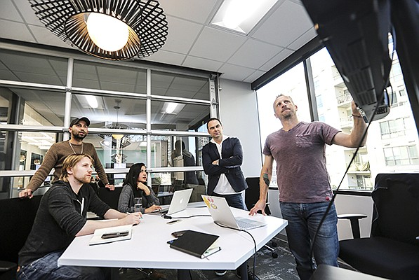The Mercato team from left to right, Mike Mason, Edmundo Ancheta, Gauri Munuswamy, Bobby Brannigan and Brian Waldman discuss an upcoming trade show that they are displaying at their new digs at Downtown Works.